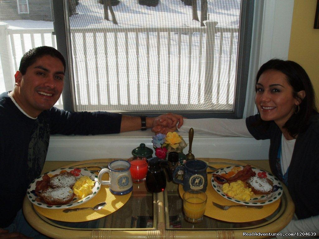 Guests enjoying one of Wayne's signature gourmet breakfasts | Image #3/15 | Stonewall Jackson Inn Bed & Breakfast