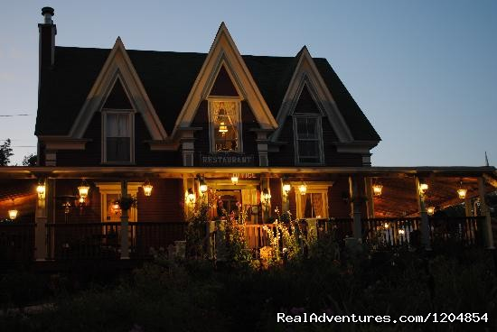 Lynwood Inn at dusk (heritage building) - Accommodation in the heart of Baddeck