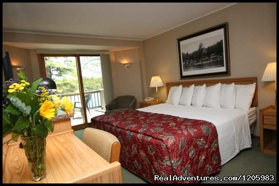 Beautiful rooms located on the Eagle River chain of lakes. Tennis court, basketball court, playground, and two beaches... Free wireless internet and DirecTV in all rooms.
