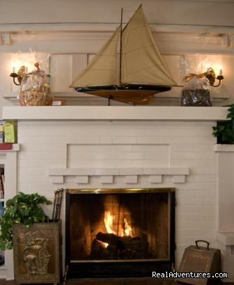 The Fireplace in the Living Room - Old Yacht Club Inn