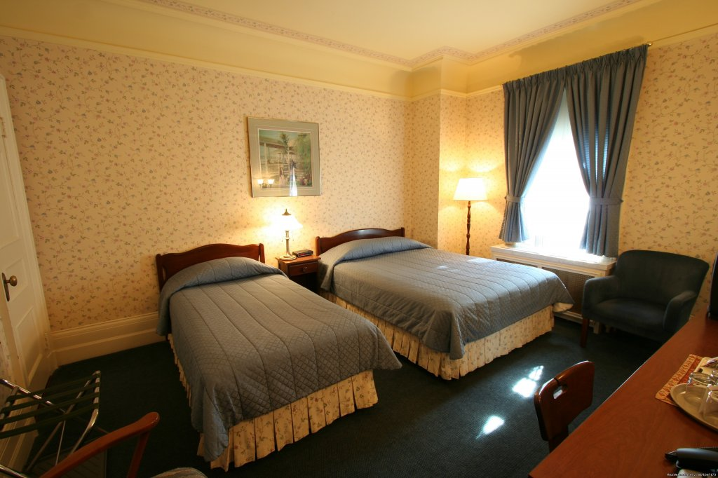Queen bed with single bed with  garden view | Image #4/6 | Old Quebec elegant small hotel