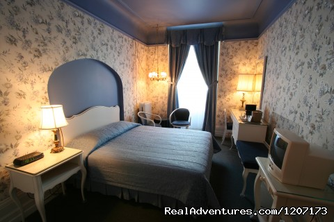 Queen bed and private balcony with front view (#3 of 6) - Old Quebec elegant small hotel