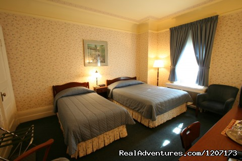Queen bed with single bed with  garden view (#4 of 6) - Old Quebec elegant small hotel