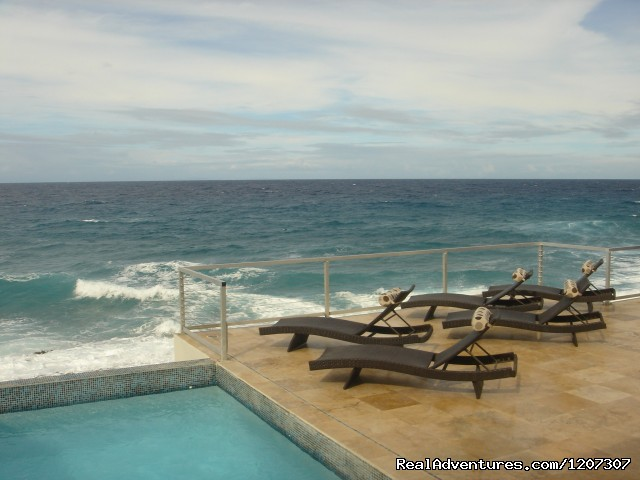 Relax on a lounge and read or dip in the pool - SeaViewPlay  New Pool & Fabulous Ocean Front Villa