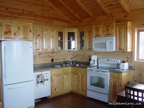 Completely furnished kitchens - Cabins on the Bluff