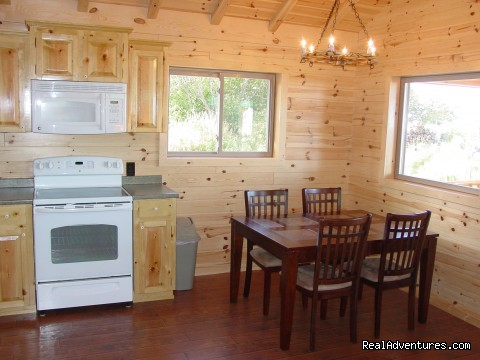 Open dining area with ocean views - Cabins on the Bluff