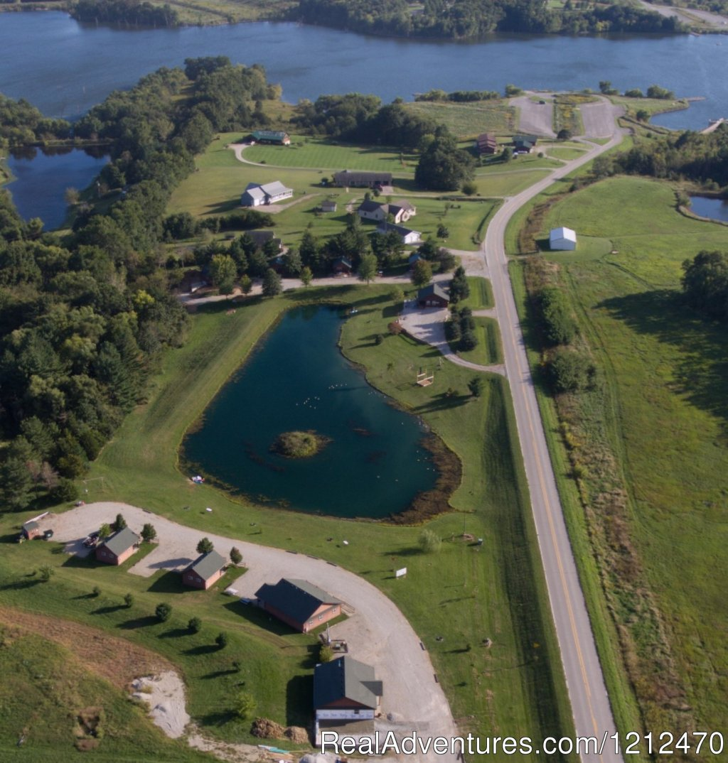 Large and small cabins surrounding private stocked pond.  Great for fishing, paddleboating, swimming at state park, free golf passes. 
