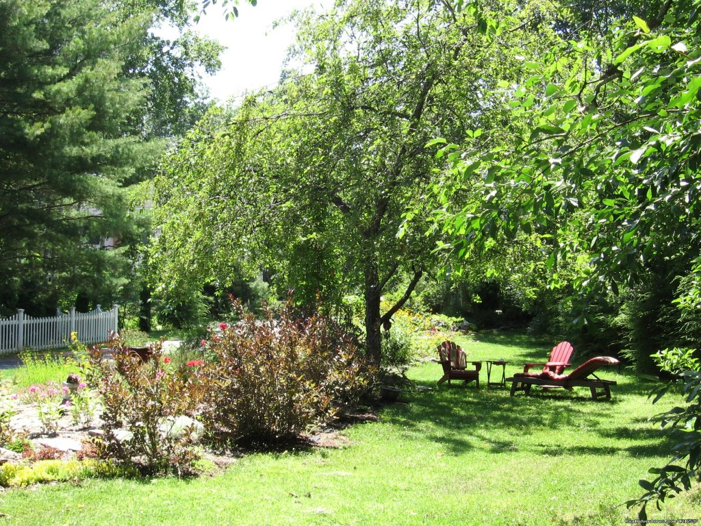 One Of Many Garden Sitting Areas | Image #18/21 | Sea Bass Cottage - Walking Distance to Ocean