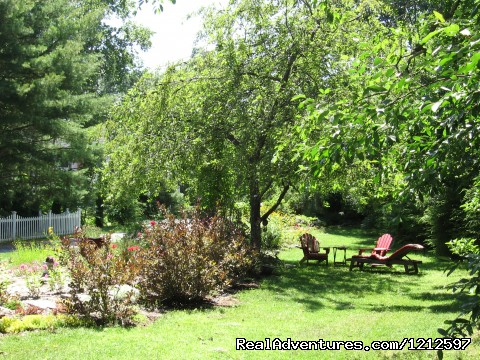 One Of Many Garden Sitting Areas (#20 of 26) - Sea Bass Cottage - Walking Distance to Ocean