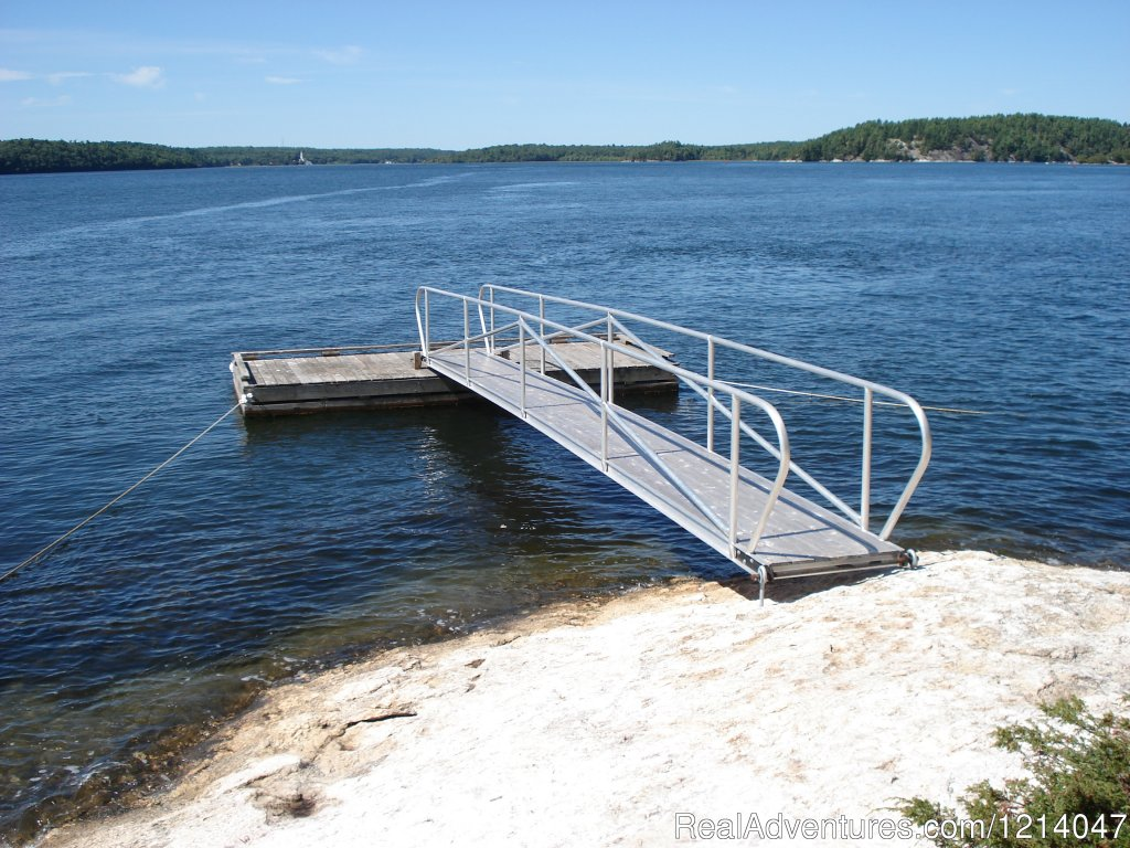 White Rocks Private Dock | Image #6/26 | Maine Coast Vacations Scenic White Rocks Cottage