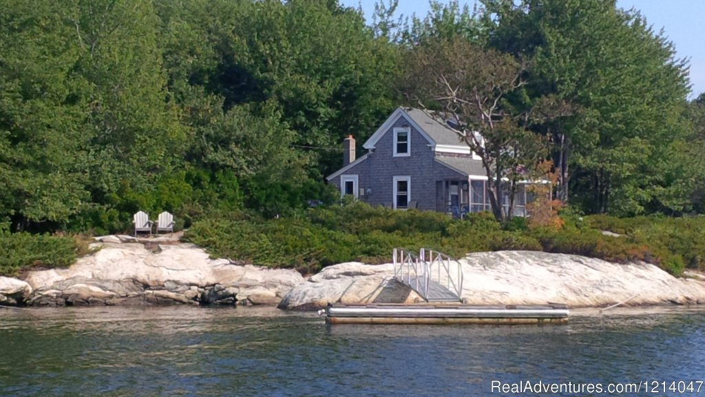 Classic Shingle Style cottage on the Maine coast. Spectacular views of islands, lighthouses, wildlife and the rugged coastline. Great kayaking/fishing. Nicely furnished. Screened porch, waterfront deck, private dock. Beach nearby. Secluded location.