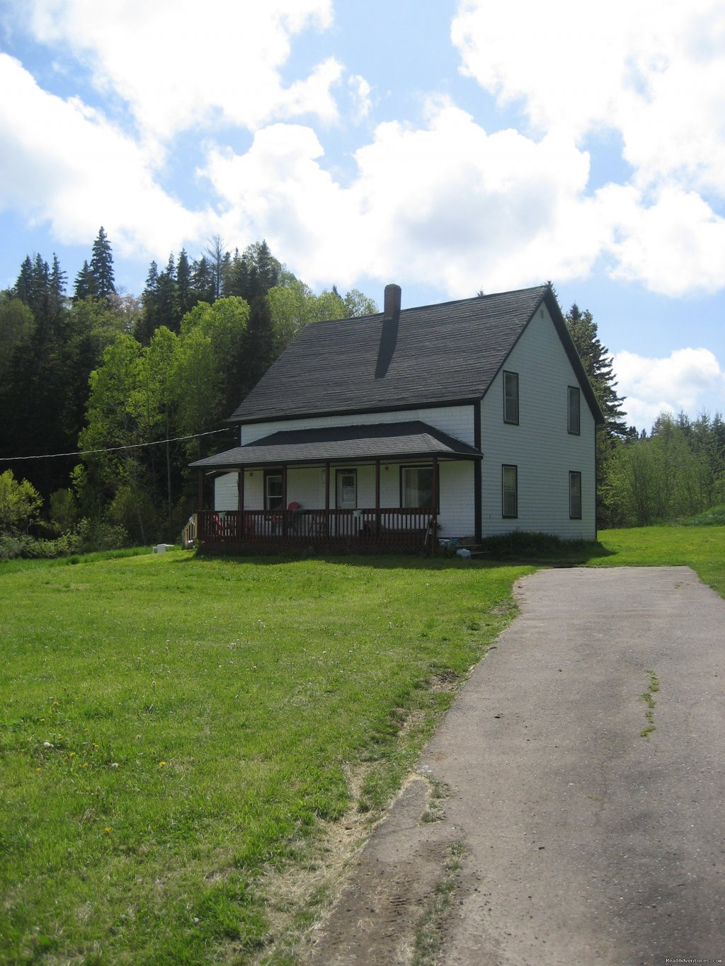 100 year old farmhouse with large kitchen, living room, dinning room, 4 bedrooms, 1 bathroom. Sits on 200 acres of land. Fish on the Margaree River. Ammentities nearby: Cabot Links golf course ,beaches, water falls, Celtic music and culture.