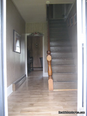 Front door  going up stairs - Farmhouse Vacation Rental in Cape Breton