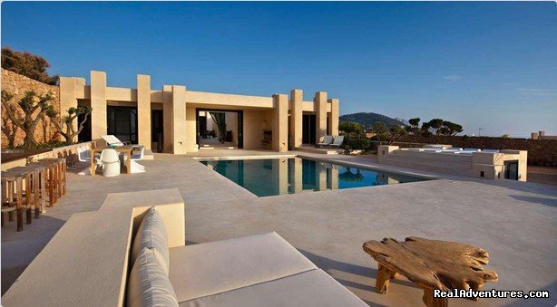 This is a wonderful villa set on the cliffs in a residential area near to Cala Vadella