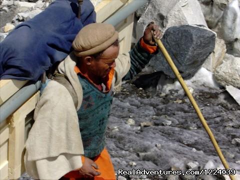 Balti Porters corssing Brado River - K2 Base Camp Gondogoro-La Trek