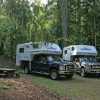 CanaDream RV Rentals & Sales - Halifax Two Truck Campers in a Wooded Campground