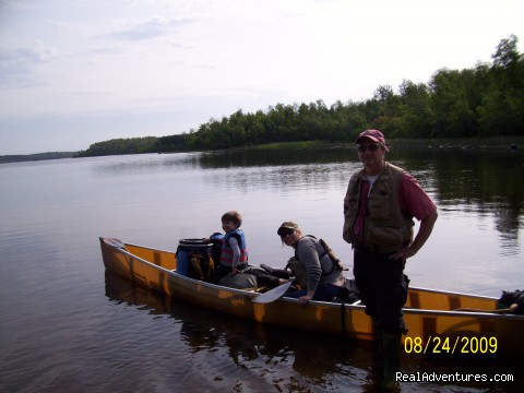 Taking off from the landing on Fall Lake (BWCA) - Autumn Canoe trip with the Grandson