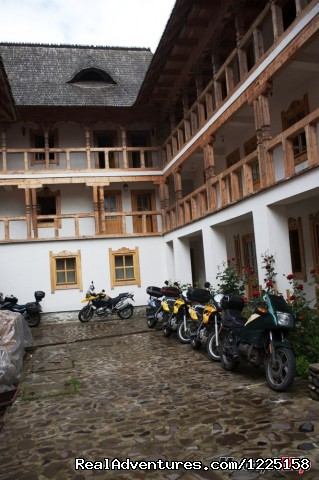 Motorcycle in the moanstery's courtyard - Best of Transylvania -7 day Motorcycle Tour