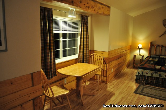 Nook With Table And Chairs (#4 of 14) - Denali Fireside Cabins & Suites