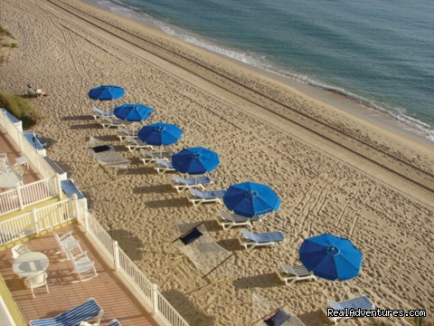 Umbrella and Lounge chairs wait your arrival - Sun Tower Hotel & Suites on the Beach