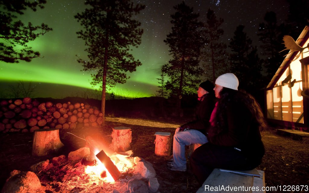 Live the Yukon adventure with Aurora Borealis and Northern Lights package tours and optional winter activities such as dog mushing, snowmobiling, snowshoeing, ice fishing, sightseeing flights and special events.