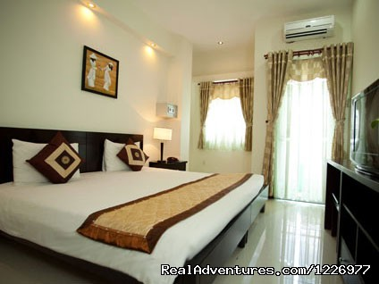 Superior King Bed - Green Suites