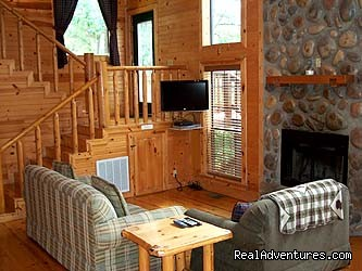 Spokane living area with 32 flatscreen LCD TV and DirecTV - Beavers Bend Log Cabins