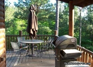 Autumn Pointe deck seating with mountain top and open sky  - Beavers Bend Log Cabins