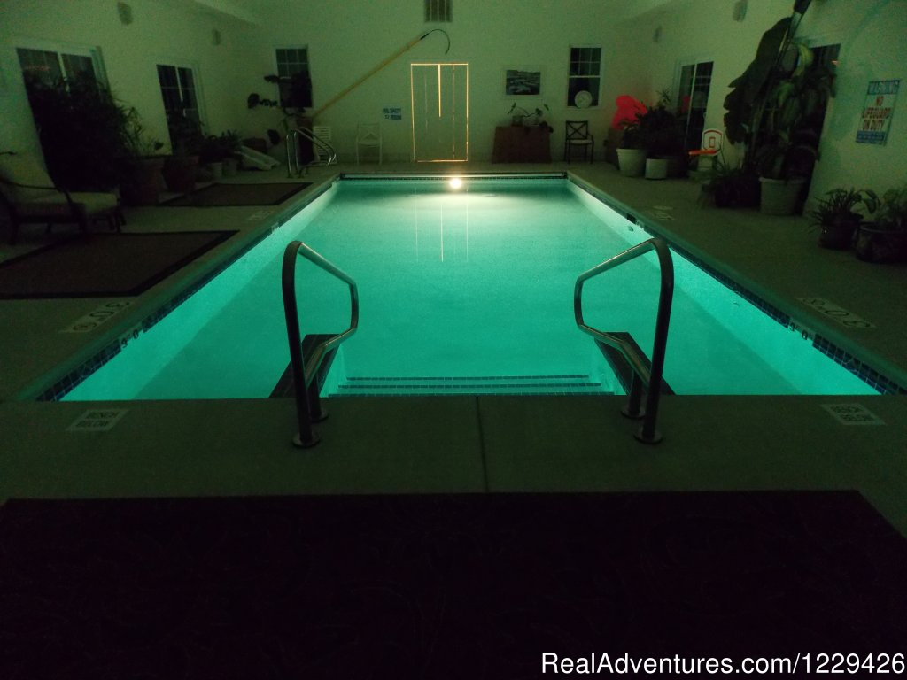 Indoor heated pool at night | Image #11/16 | Relax, Renew, Rejuvenate at Ye Olde Manor House