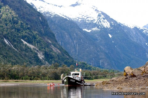 Cahuelmo support boat  - kayaking  Pumalin Park  Andean fjords Patagonia