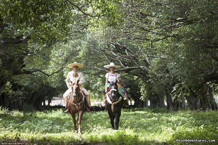 Mexican couple riding true the Lagos de Moreno ride | Image #3/13 | Horseback Riding Mexican Tours