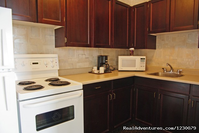 Fully equipped kitchen - One Bedroom Harbour View Suites - Victoria
