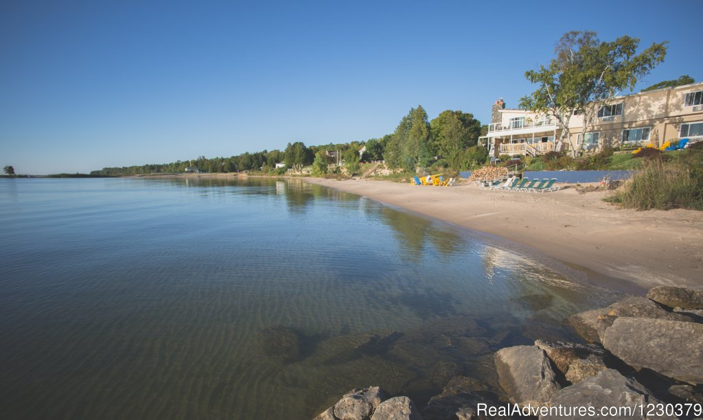 We are located in Baileys Harbor with a sand beach on beautiful Lake Michigan. Sun bathe at our pool, put your toes in the sand on our private beach, or relax on one of our Amish crafted lounge chairs. Dog friendly in first floor rooms.