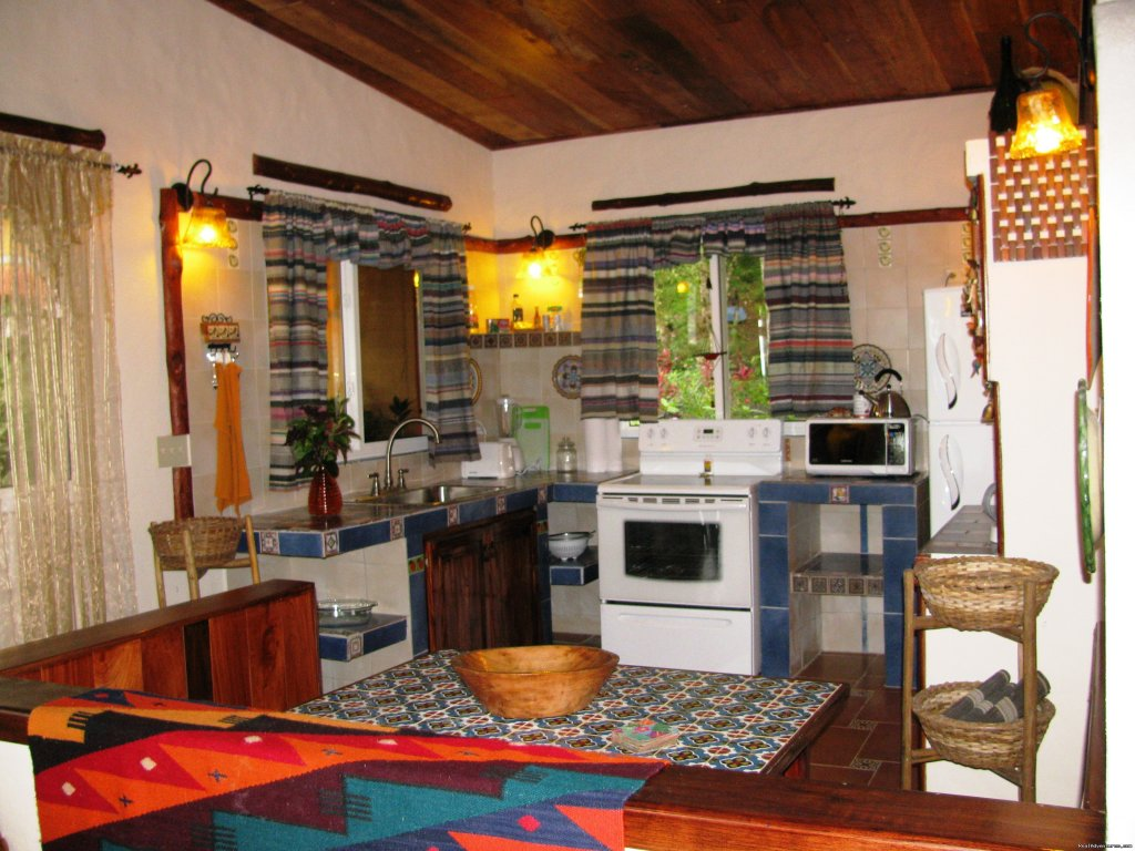 Kithen area and dining area | Image #3/25 | Cabanas en Altos del Maria, Cabins for rent.