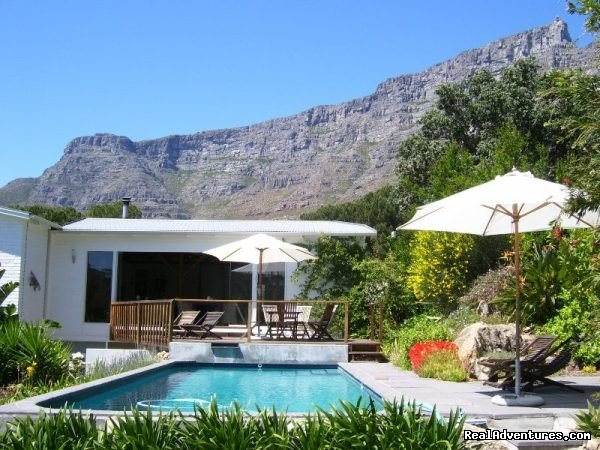 Set on the slopes of Table Mountain with panoramic views. At the top of Kloof Street, close to Waterfront, city centre and beaches. Cosy en suite bedrooms, breakfast area with sun deck, lush garden and inviting pool. Paradise awaits you ...