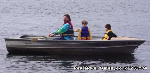 Family in row boat (#8 of 10) - Elegant Lakefront Vacation Rental