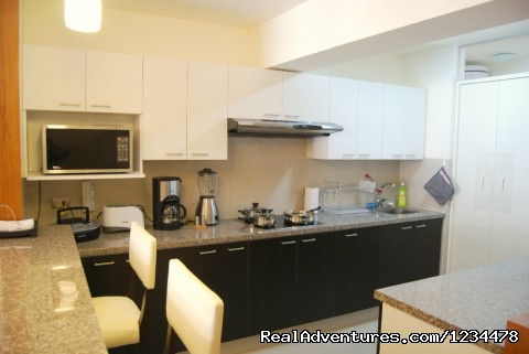 Spacious, fully equipped american kitchen - Brand new luxury condo in Av. Larco, Miraflores