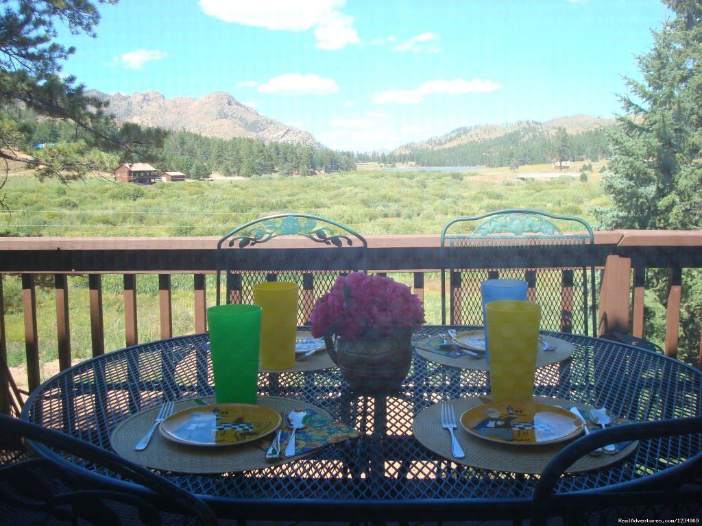 Have a meal on the deck and enjoy the view. | Image #13/26 | Pikes Peak Retreat In Pikes National Forest