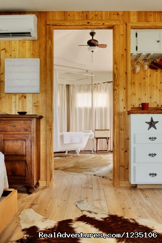 Long Leaf Pine flooring and cowhide rugs. - Fall in love all over again...Glamping at Sinya