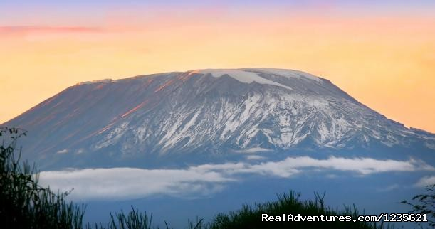 Sunrise at kilimanjaro snow peak hiking kilimanjaro - Adventure travel climbing Kilimanjaro trips