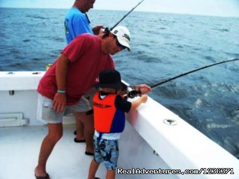 I got him dad - Alabama Charter Fishing on the Intimidator