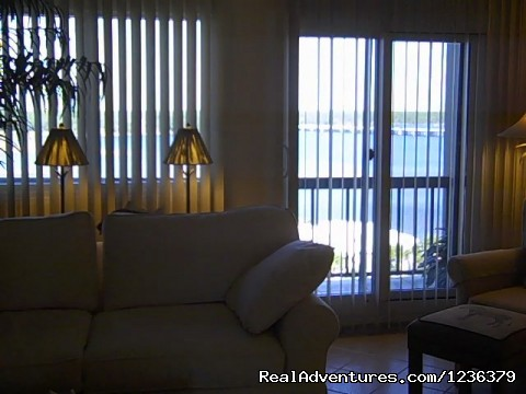 View of the balcony from the family room. - Luxury Waterfront Condo on Panama City Beach