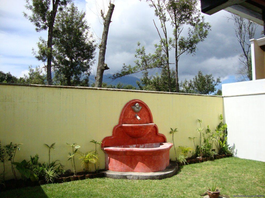 House is Ready Colonial style with fire places in the room and  living room, with a open patio with view of Volcano