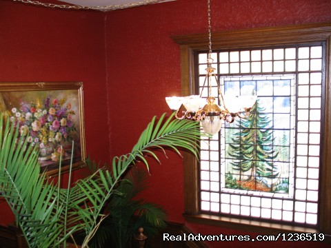 Original hand-painted leaded glass window - Greenville Inn at Moosehead Lake