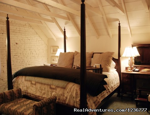 Attic Suite king bedroom in the 1200 square foot suite - Inn at Woodhaven a Romantic Bed and Breakfast i
