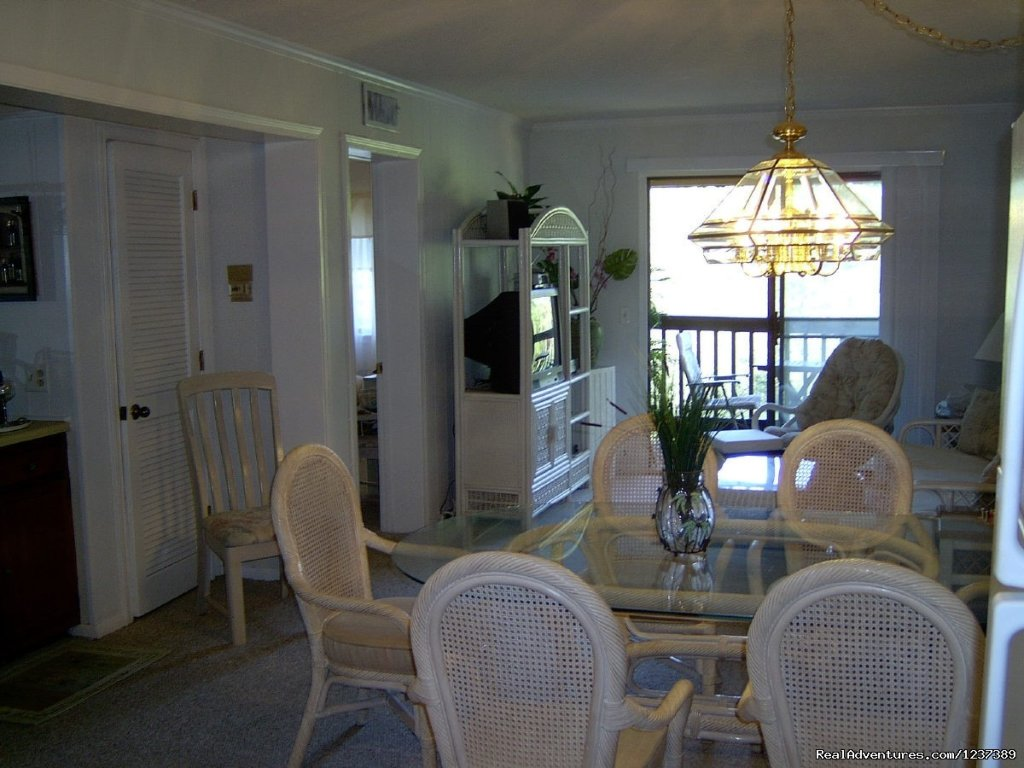 Dining into Living area and Sliding doors | Image #13/16 | OCEAN RESORT w/Largest Pool On Island On Beach