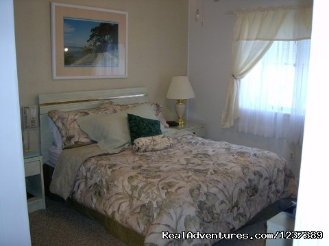 Master Bedroom with tropical Decor - OCEAN RESORT w/Largest Pool On Island On Beach