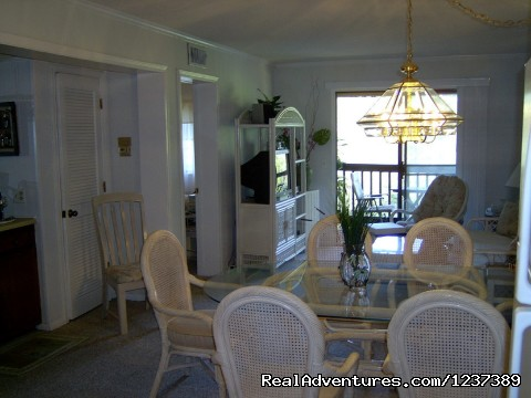 Dining into Living area and Sliding doors (#16 of 23) - OCEAN RESORT w/Largest Pool On Island On Beach