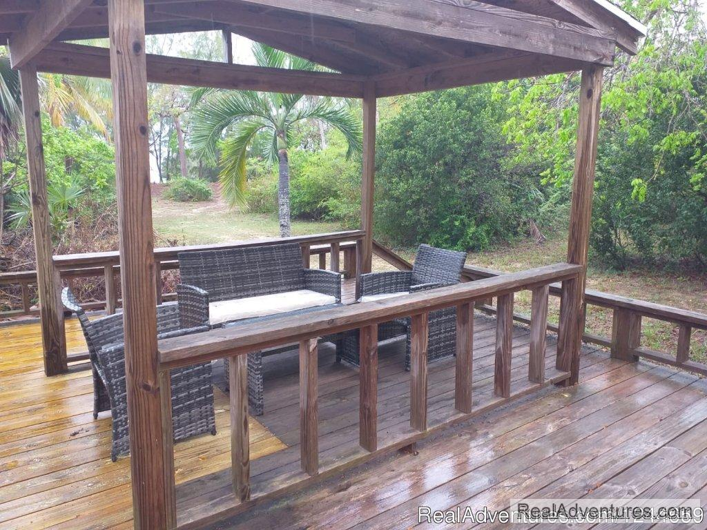 Large Deck with dinining area and gas grill | Image #5/13 | Charming 2Bed/2Bath Cottage On Secluded Pink Sand