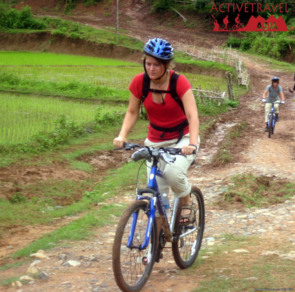 This unique biking trip in northern Vietnam takes place against a backdrop of endless lush green paddy fields and irregular tree-covered limestone mountains. 